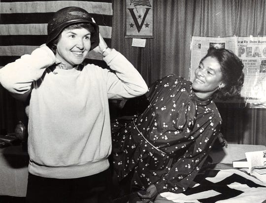 While a history teacher at Jefferson Junior High in 1981, Karen Turner tried on a Nazi helmet at her school's exhibit at the Centennial Fair at the Abilene Civic Center. Jefferson once was South Junior High, which was built during World War II. Texas history teacher Peggy Christopher looks on.