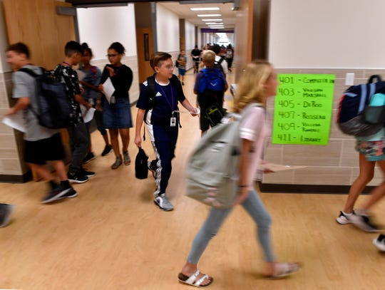 Students fill the hallways at Wylie East Junior High School on Wednesday. Making matters confusing for some on the first day of school was the layout of the brand-new school, which still is adding finishing touches.