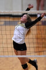Abilene High's Gentri Anderson (7) goes up for a kill in the three-set loss against Wylie at Bulldog Gym on Tuesday, Aug. 20, 2019. Anderson had nine kills in the match to lead the Lady Eagles.