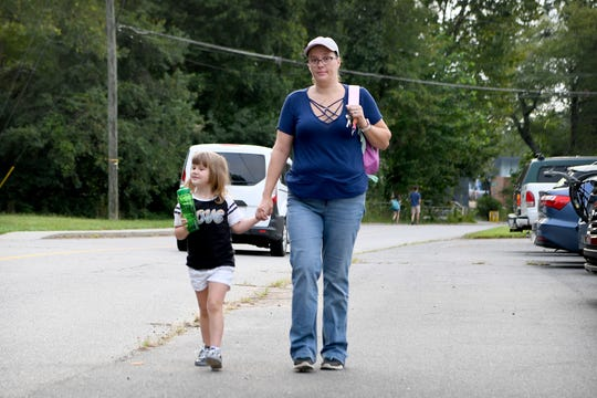Leslie Hussueng walks her daughter, Lexie, 5, into Black Mountain Primary School just after 7:30 am on Aug. 21, 2019. Hussueng says that Lexie, who has special needs, would get picked up by the bus before 6 a.m. for an 8 a.m. school start time if she wasn't able to drive her in the mornings.