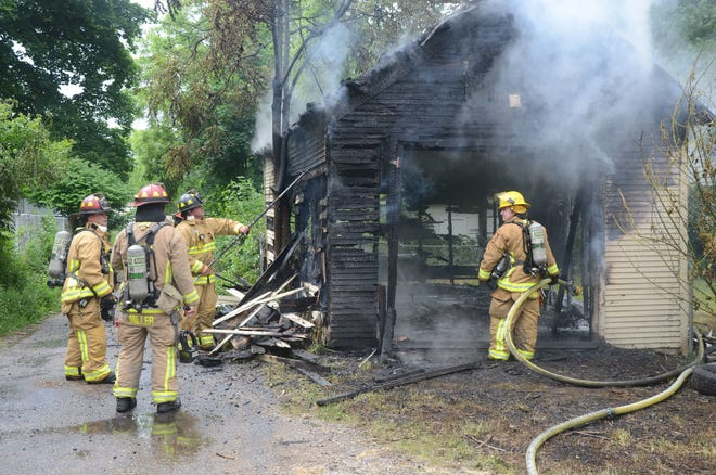 Battle Creek firefighters extinguish a fire in a garage at 41 S. Wabash St on June 12, 2018. Later that day two boys said they had been raped several times in the building.