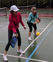 Pickleball players compete at Battle Point Park.