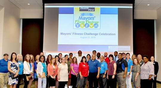 Brevard mayors and other community representatives are pictured Wednesday at the Health First 2019 Mayors' Fitness Challenge celebration breakfast at the Space Coast Health Foundation Center for Collaboration and United Way of Brevard in Rockledge.