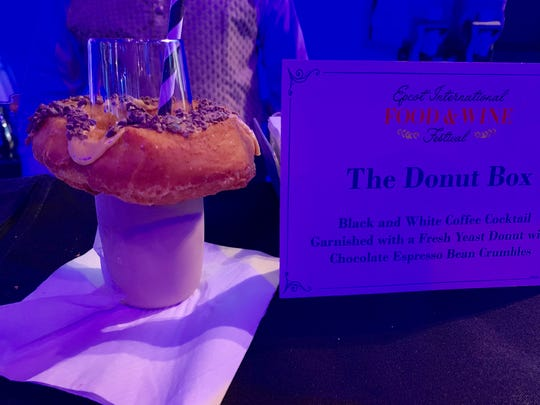 The Black and White Coffee Cocktail at the Epcot Food & Wine Festival is garnished with a yeast doughnut.