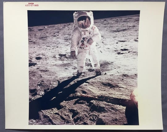 This image of Neil Armstrong, reflected in Buzz Aldrin's visor on the lunar surface during the historic Apollo 11 mission, is among items for sale during a two-day auction benefiting the American Space Museum.