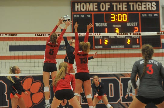 Bellevue's Taylor Baxter (5) and Claire Turner (13) attempt to block Galion's Kerrigan Myers.
