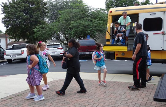 Students arrive at Bucyrus Elementary School for the first day of classes on Wednesday.