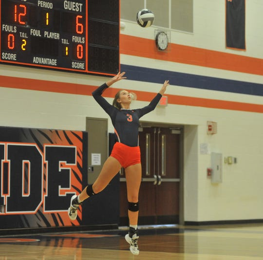 Galion's Taylor Keeran leaps up during a serve against Bellevue.