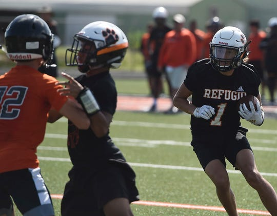 Refugio's Jordan Kelley runs a route at football practice, Wednesday, Aug. 21, 2019.