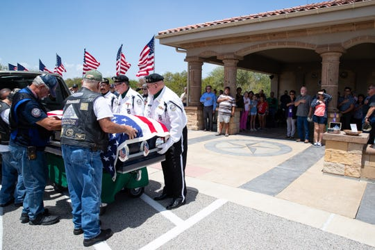 The casket for Army Pfc. William Conely Carroll Jr. arrives at the Coastal Bend Texas State Veterans Cemetery on Wednesday, Aug. 21, 2019.