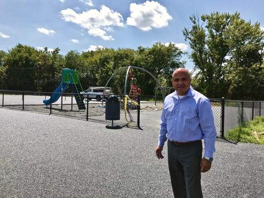 Camden Mayor Frank Moran stands in front of a new playground in front of Malandra Hall in Fairview.