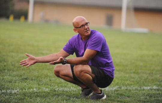 Unioto girls soccer head coach Jeremy Clark discusses the game with the Shermans on the bench in a 6-1 win over Hillsboro at Unioto High School on Aug. 20, 2019.