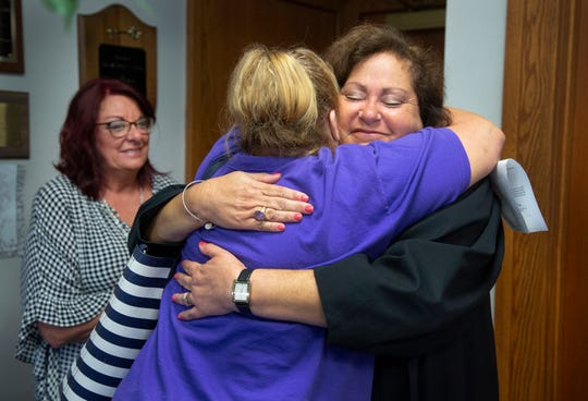 Roberta hugs Municipal Judge Heather Russell after the judge sealed her criminal record.