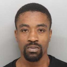 Perry Cameron, 27, was arrested Wednesday in connection to the fatal shooting of Anthony Hinton, according to police.