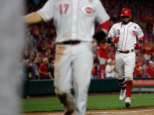 Cincinnati Reds second baseman Freddy Galvis (3) hits a two-run home run to drive in first baseman Josh VanMeter (17) in the sixth inning of the MLB National League game between the Cincinnati Reds and the San Diego Padres at Great American Ball Park in downtown Cincinnati on Tuesday, Aug. 20, 2019. The Reds evened the series with a 3-2 win over the Padres, behind a 10-strikeout outing by Sonny Gray.