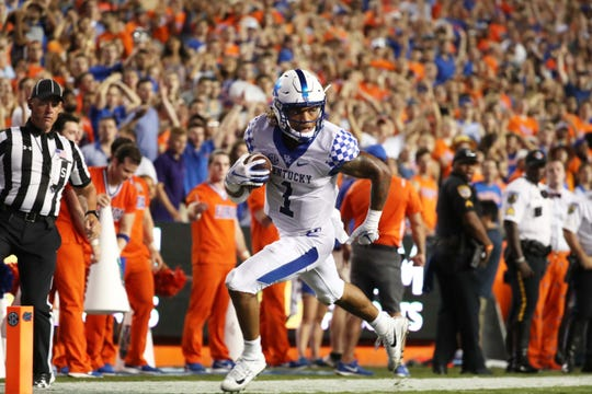 Sep 8, 2018; Gainesville, FL, USA; Kentucky Wildcats wide receiver Lynn Bowden Jr. (1) catches the ball and runs it in for a touchdown against the Florida Gators at Ben Hill Griffin Stadium. Kentucky Wildcats defeated the Florida Gators 27-16.