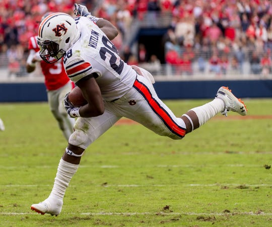 Oct 20, 2018; Oxford, MS, USA; Auburn Tigers running back JaTarvious Whitlow (28) against the Mississippi Rebels during the second half at Vaught-Hemingway Stadium.