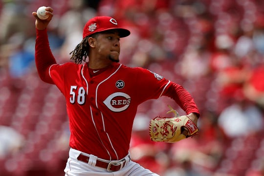 Cincinnati Reds starting pitcher Luis Castillo (58) delivers a pitching the first inning of the MLB National League game between the Cincinnati Reds and the San Diego Padres at Great American Ball Park in downtown Cincinnati on Wednesday, Aug. 21, 2019. The Reds led 3-1 after three innings.