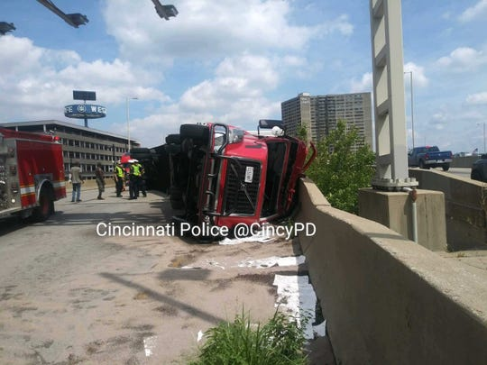Overturned semi on I-71 will slow traffic through this evening.