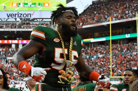 Oct 6, 2018; Miami Gardens, FL, USA; Miami Hurricanes linebacker Michael Pinckney (56) celebrates with the turn over chain after intercepting a pass during the second half against the Florida State Seminoles at Hard Rock Stadium.