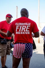 Chief Freddie Montgomery shows off shorts with an American flag print he wore under his gear during the CFD's agility testing course at Clarksville Fire Rescue downtown in Clarksville, Tenn., on Tuesday, Aug. 20, 2019.
