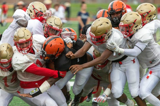Woodbridge High School football team scrimmages with Edison, Linden and Jackson Memorial today at 10 a.m. at the school football field.