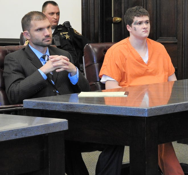 Attorney Ben Whitacre with client Michael A. Murray, 19, of Newcomerstown in Coshocton County Common Pleas Court. Murray received 48 months in prison in three separate cases mainly relating to burglaries and thefts.
