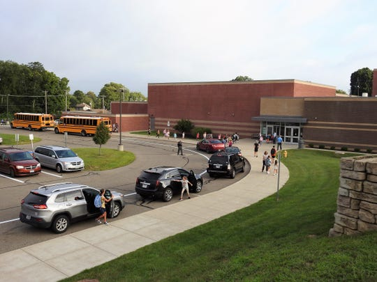 Cars and buses drop off students for the first day of school Wednesday at Coshocton Elementary School.