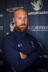 Roosevelt head varsity football coach Mitchell Moore is the third head coach at the school in four years. Since taking over the program, he's enlisted the help of former Iowa and Iowa State football players to help rebuild the program.