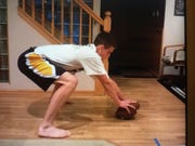 Steve Wirtel practices long snapping in the basement of his parents' house.