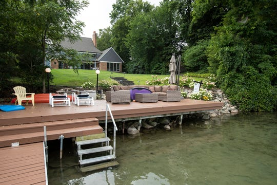 A large deck and dock extend over the edge of the 100-acre lake. Green Lake allows only human-, electric- or wind-powered craft, so it remains quiet. The owners' pontoon raft is included in the sale.