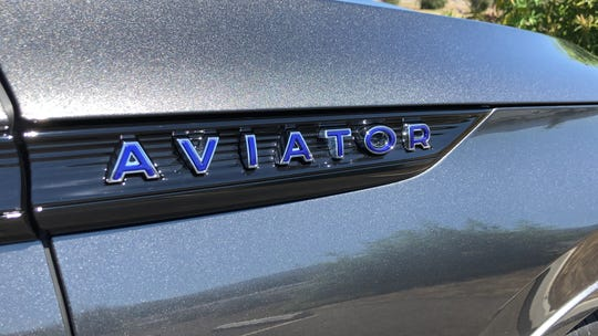"The Aviator Grand Touring's badges feature ""spirit blue,"" a color Lincoln used on V12 models in the 1930s and '40."