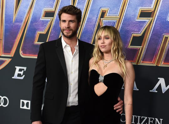 "In this April 22, 2019, photo, Liam Hemsworth and Miley Cyrus arrive at the premiere of ""Avengers: Endgame"" at the Los Angeles Convention Center. Liam Hemsworth is seeking a divorce from Miley Cyrus after seven months of marriage."
