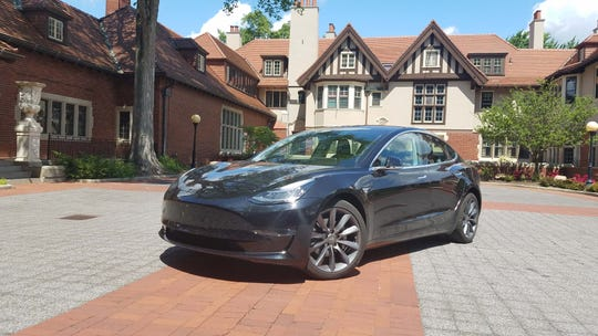 The Tesla Model 3 EV poses at Cranbrook School near Woodward. The 3 was the best-selling luxury car in America in its first full model year.