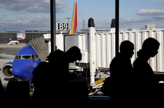 FILE - In this Nov. 20, 2018, file photo travelers wait in line to board a flight at Baltimore-Washington International Thurgood Marshall Airport in Linthicum, Md. Airlines expect record crowds over the week-long Labor Day period, continuing a rise in travel that has boosted the airlines' profits all year.