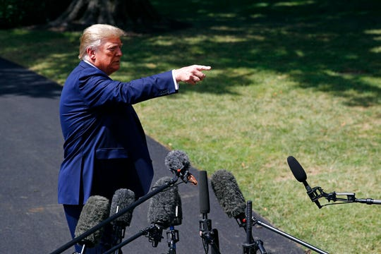 "President Donald Trump speaks with reporters on the South Lawn, Wednesday, Aug. 21, 2019, in Washington. A day after considering cutting taxes to promote economic growth, Trump changed course and said he would abandon the idea, ""We don't need it. We have a strong economy."""