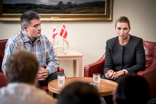 Danish Prime Minister Mette Frederiksen, right, speaks with Kim Kielsen, leader of Greenland's Naalakkersuisut party, during a press conference in Nuuk, Greenland, Monday, Aug. 19 2019. Frederiksen, will meet with other members of the Naalakkersuisut party, representatives of labor organizations, different businesses and the Joint Arctic Command.