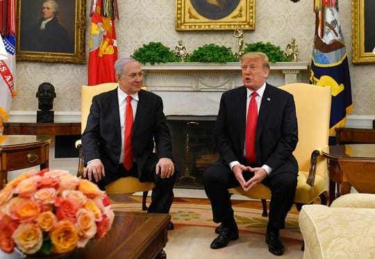 In this March 25, 2019, file photo, President Donald Trump, right, speaks as Israeli Prime Minister Benjamin Netanyahu listens in the Oval Office. Netanyahu on Wednesday, Aug. 21, 2019, is steering clear of Trump's comments questioning the loyalty of American Jews who support the Democratic Party, ignoring condemnation from Jewish critics who accuse him of voicing longstanding anti-Semitic tropes.
