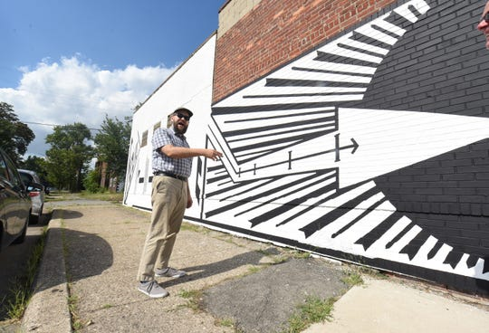 Detroit artist Ryan Standfest discusses his mural on the side of Detroit's Holding House on Michigan Avenue. The Wayne State professor mostly paints at night.