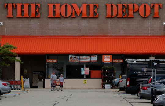 Shoppers leave the Home Depot store in Manchester, N.H., Thursday, Aug. 15, 2019.  The Home Depot Inc. (HD) on Tuesday, Aug. 20, reported fiscal second-quarter net income of $3.48 billion. On a per-share basis, the Atlanta-based company said it had net income of $3.17.