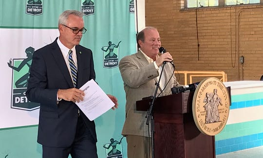 Detroit Mayor Mike Duggan speaks beside Eric Dietz, regional president of Huntington Bank, during the announcement of Huntington's $5 million investment in the Warrendale/Cody Rouge neighborhood through the city's Strategic Neighborhood Fund and Affordable Housing Leverage Fund.
