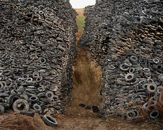 """Oxford Tire Pile #8"" by Edward Burtynsky in ""Life Is a Highway: Art and American Car Culture."""