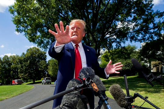"""President Donald Trump speaks with reporters before departing on Marine One on the South Lawn of the White House, Wednesday, Aug. 21, 2019. President Donald Trump said Wednesday that he's not looking to cut taxes by indexing capital gains and that doing so would be perceived as """"somewhat elitist"""" as it would benefit the wealthy."""
