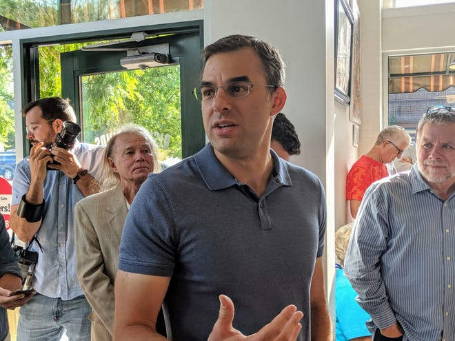 U.S. Rep. Justin Amash speaks to constituents at the Rising Grind Cafe in Grand Rapids on Aug. 21, 2019.