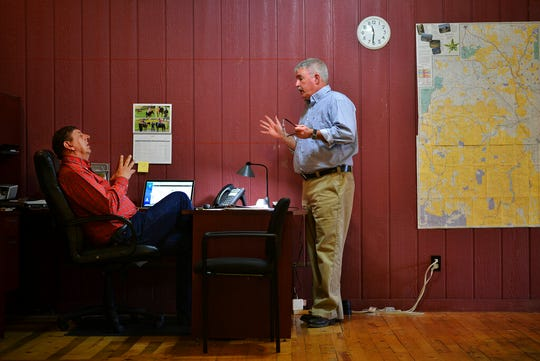 In this Monday, April 16, 2018, photo reporter Pat Caldwell, right, talks to Malheur Enterprise Publisher Les Zaitz about a story he is developing while working on deadline for the newspaper in Vale, Ore.