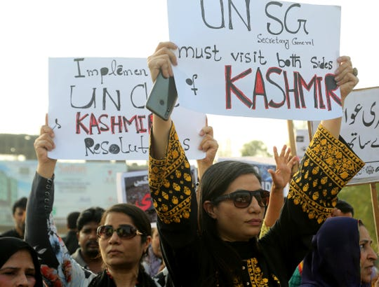 Pakistani civil society activists rally to express solidarity with Indian Kashmiris in Lahore, Pakistan, Tuesday, Aug. 20, 2019. Sardar Masood, the president of Pakistani-administered Kashmir has welcomed efforts by U.S. President Donald Trump to lower tensions between Pakistan and India over the disputed Himalayan region and warned of a humanitarian crisis and food shortages in the Indian-held portion.