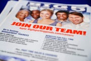 A flyer advertises job openings during a job fair in San Jose, Calif.