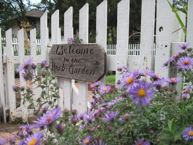 A sign on the gate of an old-fashioned herb garden welcomes visitors. Parsley, sage, rosemary and thyme are all great choices for an herb garden, but go ahead and experiment with herbs you haven't tried to grow before, and don't forget to grow ornamental flowers in your herb garden, too, says Gayle Engels of the American Botanical Council.