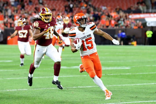 Damon Sheehy-Guiseppi runs for an 86-yard punt return during the second half of an NFL preseason game against the Washington Redskins on Aug. 8.