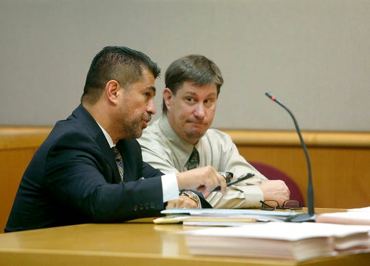 "In an Oct. 19, 2018 file photo, attorney Bryant Camareno talks to his client defendant Michael Drejka during a pretrial hearing, at the Pinellas County Criminal Justice Center in Clearwater, Fla. The manslaughter trial of Drejka, accused of fatally shooting an unarmed black man in a Florida parking lot, will focus on the state's controversial ""stand your ground law."""